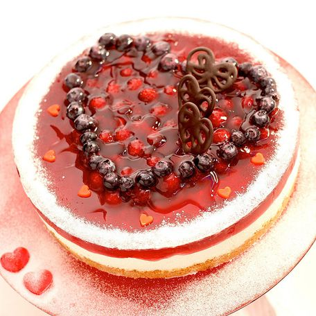 Small fruit cake with big raspberry heart